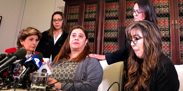 Attorney Gloria Allred, left, is seen with four Park Avenue Elementary School teachers at a Los Angeles news conference on Friday.