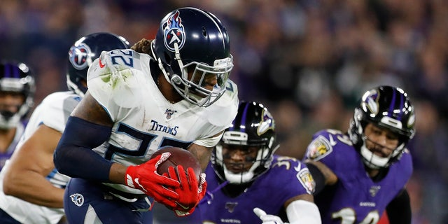 Tennessee Titans running back Derrick Henry (22) runs against the Baltimore Ravens during the first half an NFL divisional playoff football game, Saturday, Jan. 11, 2020, in Baltimore. (AP Photo/Julio Cortez)