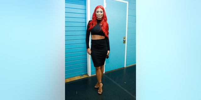 Eva Marie, a former wrestler with the WWE, claims she was booted from the lounge for wearing, well, loungewear.