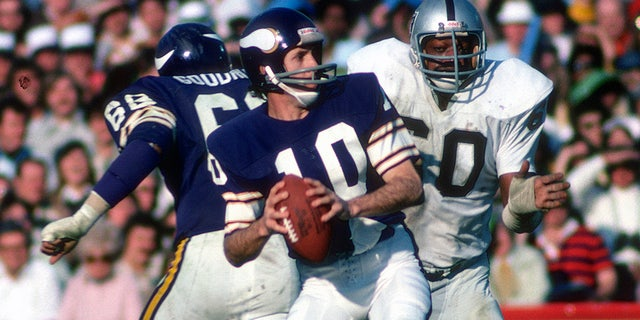 Fran Tarkenton #10 of the Minnesota Vikings drops back to pass pressured by Otis Sistrunk #60 of the Oakland Raiders during Super Bowl XI on January 9, 1977 at the Rose Bowl in Pasadena, California. The Raiders won the Super Bowl 32 -14. (Photo by Focus on Sport/Getty Images)