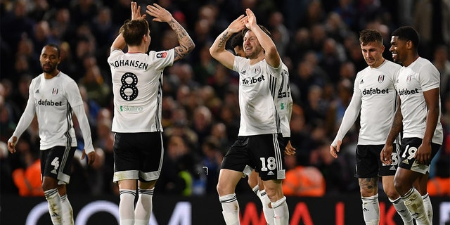 Harry Arter of Fulham celebrates scoring the second Fulham goal with teammates during the FA Cup Third Round match between Fulham FC and Aston Villa at Craven Cottage on January 04. The team is wearing its signature white jerseys. (Photo by Justin Setterfield/Getty Images)