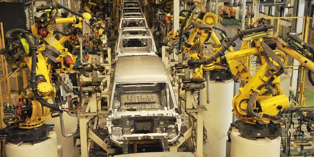 The General Motors ad features a robot from the assembly line. (Photo credit should read YU FANGPING / Barcroft Media via Getty Images)