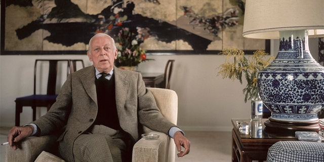 "Alistair Cooke poses for a portrait in February 1983 in a hotel in San Francisco, California. Cooke was the longtime host of the PBS show ""Masterpiece Theatre."""
