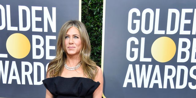 Brad Pitt and Jennifer Aniston reunite at Golden Globes