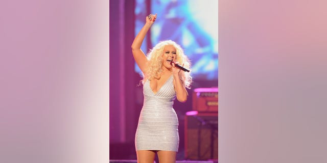 Christina Aguilera performs onstage at the 2011 American Music Awards. (Photo by Kevork Djansezian/Getty Images)