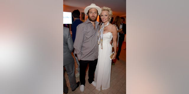 Pamela Anderson and Rick Salomon at The Pamela Anderson Foundation launch in Cannes, France in 2014.