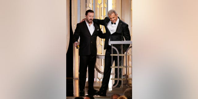 Host Ricky Gervais and presenter Mel Gibson speak onstage during the 73rd Annual Golden Globe Awards at The Beverly Hilton Hotel on January 10, 2016 in Beverly Hills, California.