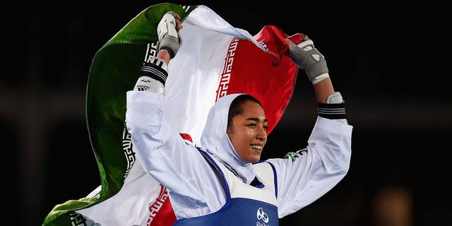 ​​​​​​​Kimia Alizadeh Zenoorin of Iran celebrates after defeating Nikita Glasnovic of Sweden during a women's Bronze Medal Taekwondo contest at the 2016 Summer Olympics, Aug. 18, 2016 in Rio de Janeiro, Brazil. (Getty Images)