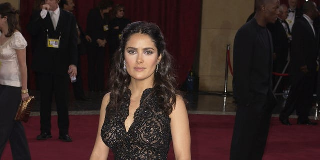 Salma Hayek seen donning the dress her close pal actress Renee Zellweger lent her at the eleventh hour and wearing a bracelet by Martin Katz at the Kodak Theater in Hollywood Calif