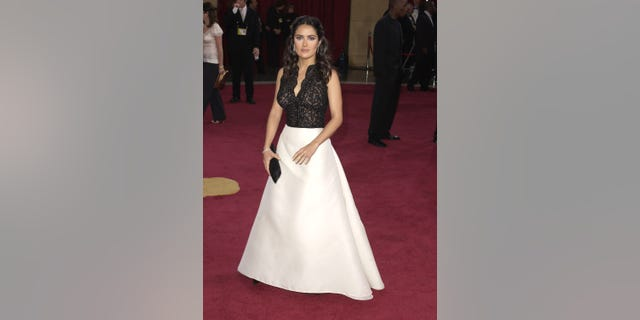 Salma Hayek seen donning the dress her close pal actress Renee Zellweger lent her at the eleventh hour and wearing a bracelet by Martin Katz at the Kodak Theater in Hollywood, Calif. (Photo by Steve Granitz/WireImage)