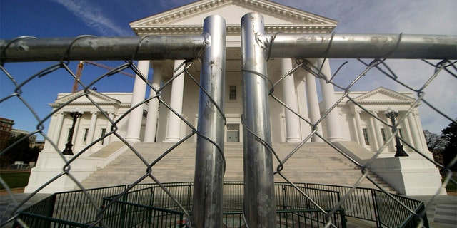 The Virginia state Capitol building is surrounded by fencing, Thursday, Jan. 16, 2020, in Richmond, Va., in preparation for Monday's rally by gun rights advocates. (Dean Hoffmeyer/Richmond Times-Dispatch via AP)