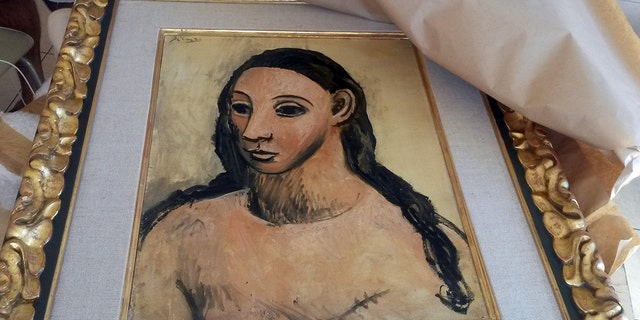 The seized painting 'Head of a young woman' by famous Spanish painter Picasso, at the Customs offices in Calvi.