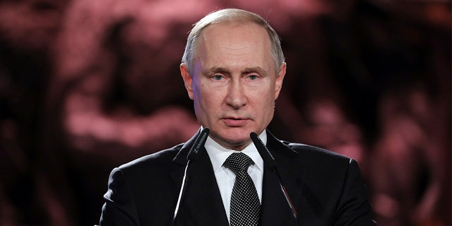 Russian President Vladimir Putin speaks during the Fifth World Holocaust Forum at the Yad Vashem Holocaust memorial museum in Jerusalem, Israel, Thursday, Jan. 23, 2020. The event marking the 75th anniversary of the liberation of Auschwitz under the title 'Remembering the Holocaust: Fighting Antisemitism' is held to preserve the memory of the Holocaust atrocities by Nazi Germany during World War II. (Abir Sultan, Pool via AP)