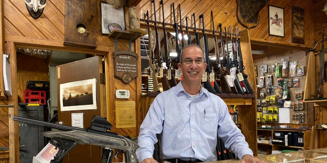 Carey Baker, co-owner of A.W. Peterson Gun Shop in Mount Dora, Florida.