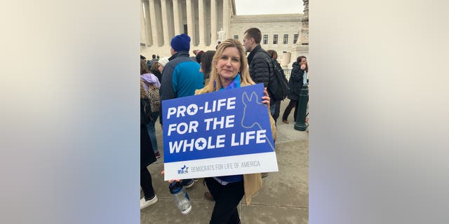 Jeannie French, 59, of Pittsburgh holds a Democrats for Life sign outside of the Supreme Court on Friday, Jan. 24.