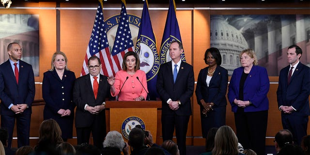 House Speaker Nancy Pelosi of Calif., fourth from left, speaks during a news conference to announce impeachment managers on Capitol Hill in Washington, Wednesday, Jan. 15, 2020.  (AP Photo/Susan Walsh)