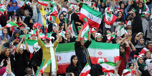 Iranian fans support their national football team during 2022 FIFA World Cup Asia qualifications Group C soccer match between Iran and Cambodia at Azadi Stadium in Tehran, Iran.TheAsian Football Confederation (AFC) has banned the country from hosting international matches.(Photo by Stringer /Anadolu Agency via Getty Images)