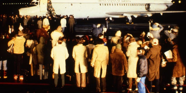 The first of the 52 American hostages freed from Iran, leave a U.S. Airforce hospital plane after its arrival at Rhein-Main Air Base, near Frankfurt, Germany, January 21, 1981. (AP Photo/Str)