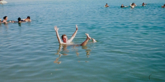 Jason Cohen, who went on the first Birthright Israel trip in 2000, floats in the Dead Sea with his group from Hofstra University Hillel.