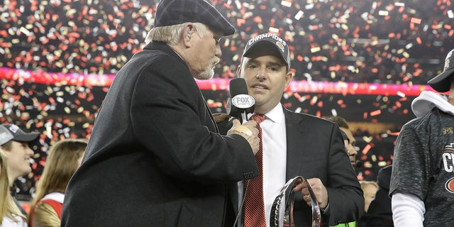 San Francisco 49ers owner Jed York, center, is interviewed by Terry Bradshaw after the NFL NFC Championship football game against the Green Bay Packers Sunday, Jan. 19, 2020, in Santa Clara, Calif. The 49ers won 37-20 to advance to Super Bowl 54 against the Kansas City Chiefs. (AP Photo/Marcio Jose Sanchez)