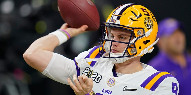 LSU quarterback Joe Burrow warms up before a NCAA College Football Playoff national championship game against Clemson Monday, Jan. 13, 2020, in New Orleans. (AP Photo/David J. Phillip)