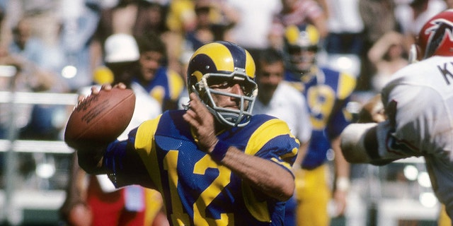 Los Angeles Ram's quarterback Joe Namath # 12 went back to pass against the Atlanta Falcons during an NFL football game on December 11, 1977 at the Los Angeles Memorial Coliseum in California.  Namath played for Rams in 1977.  (Photos for Sport / Getty Images)