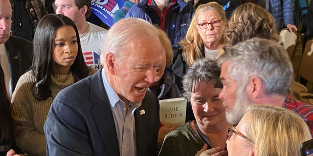 Democratic presidential candidate Joe Biden speaks with voters at campaign event in Claremont, NH on Jan. 24, 2020