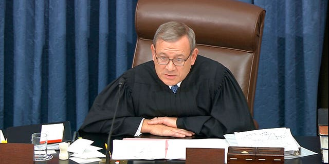 In this image from video, presiding officer Supreme Court Chief Justice John Roberts admonishes the impeachment managers and president's counsel in equal terms as he speaks during the impeachment trial against President Donald Trump in the Senate. Roberts, who fastidiously avoids politics, was forced to step into the fray to fulfill his constitutional duty to oversee a Senate impeachment trial earlier this year. (Senate Television via AP)