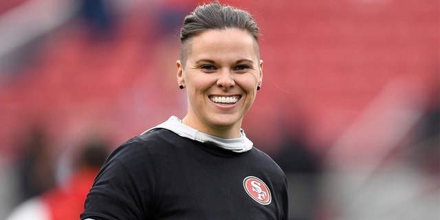 San Francisco 49ers offensive assistant Katie Sowers stands on the field before their NFC Championship game against the Green Bay Packers at Levi's Stadium in Santa Clara, Calif. (Jose Carlos Fajardo/Bay Area News Group)
