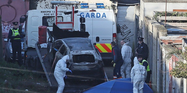A burnt out car which contained human remains, believed to be linked to the disappearance of a 17-year-old boy from Co Louth, is removed from the scene on Trinity Terrace in the Drumcondra area of Dublin. (Press Association via AP Images)