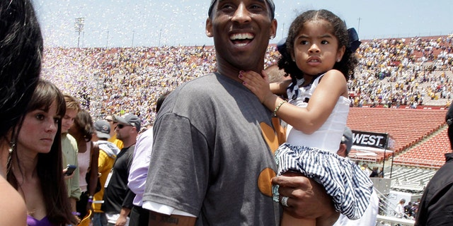 Los Angeles Lakers' Kobe Bryant with his daughter Gianna in 2009. Both died in the helicopter crash Sunday. (AP Photo/Jae C. Hong, File)