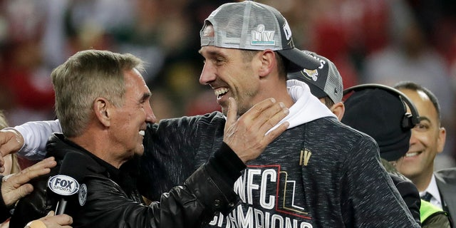 Kyle Shanahan celebrates with his father, Mike, after winning the NFC Championship. (AP Photo/Matt York)