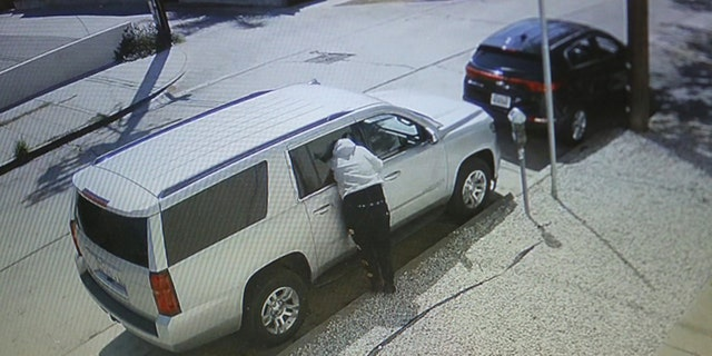A person burglarizes a vehicle in broad daylight and is caught on video at La Jolla and Melrose avenues in Los Angeles.