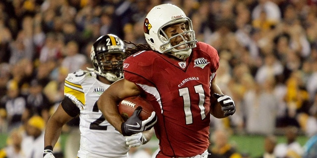 Cardinals Larry Fitzgerald runs in for a touchdown in the fourth quarter as the Pittsburgh Steelers face the Arizona Cardinals in Super Bowl XLIII at Raymond James Stadium in Tampa, Florida, Sunday, February 1, 2009. (Photo by Mark Cornelison/Lexington Herald-Leader/Tribune News Service via Getty Images)