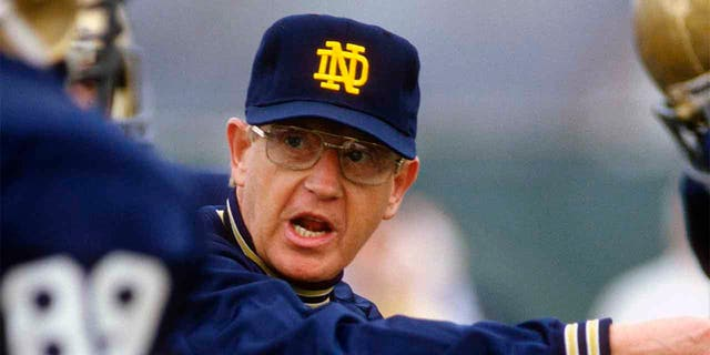 Head Coach Lou Holtz of the Notre Dame Fighting Irish gives instructions to his players during a practice circa 1988 at Notre Dame in South Bend, Indiana. Holtz coached the Notre Dame Fighting Irish from 1986-1996. (Photo by Focus on Sport/Getty Images)<br>