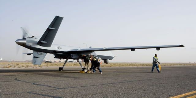 Aircrews perform a preflight check on an MQ-9 Reaper before it takes of for a mission in Afghanistan Sept. 31. The Reaper is larger and more heavily-armed than the MQ-1 Predator and in addition to its traditional ISR capabilities, is designed to attack time-sensitive targets with persistence and precision, and destroy or disable those targets. (Courtesy of the United States Air Force)