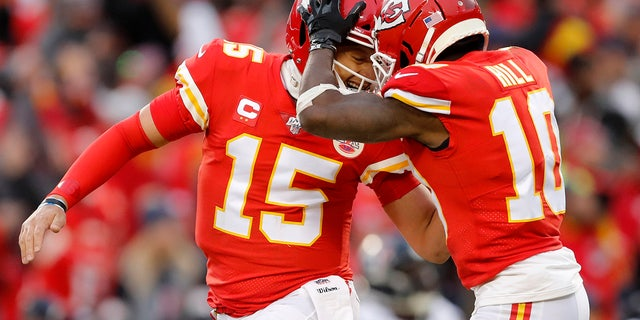Kansas City Chiefs quarterback Patrick Mahomes (15) celebrating with wide receiver Tyreek Hill during the first half of their playoff game against the Houston Texans. (AP Photo/Jeff Roberson)