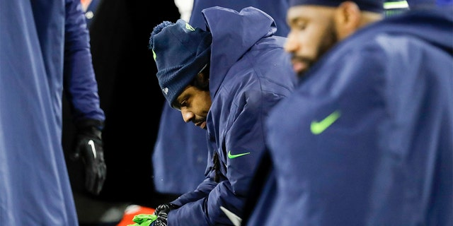 Seattle Seahawks' Marshawn Lynch sits on the bench during the second half an NFL divisional playoff football game against the Green Bay Packers Sunday. (AP Photo/Darron Cummings)