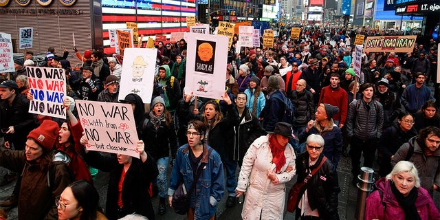 People took part in an anti-war protest at Times Square. (REUTERS/Eduardo Munoz)