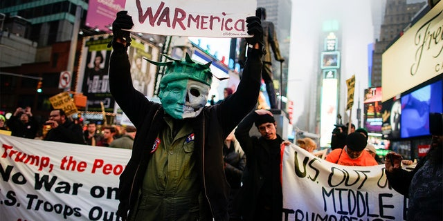 People took part in an anti-war protest at Times Square in New York. (REUTERS/Eduardo Munoz)