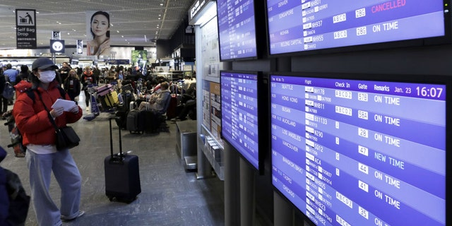 Across the globe — and as seen here on a departures board at the Narita airport in Japan — flights to certain regions of China have been canceled amid reports concerning the novel coronavirus first identified in Wuhan.