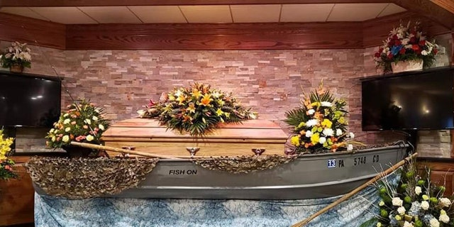 Frey's casket was placed inside Frey's own 16-foot aluminum fishing boat, which had been passed down from his grandfather and father, for the viewing.