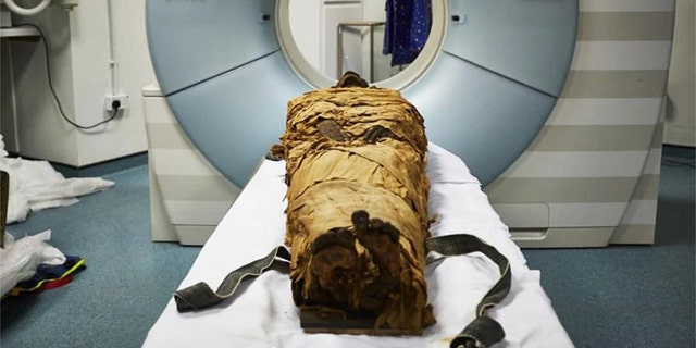 The mummified body of Nesyamun laid on the couch to be CT scanned at Leeds General Infirmary. (Leeds Teaching Hospitals/Leeds Museums and Galleries)
