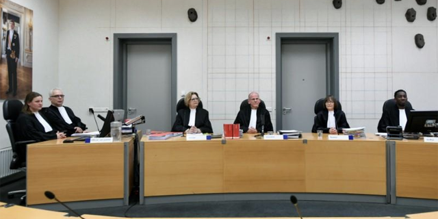 Judges sit in the Assen, Netherlands courtroom before a first procedural hearing of a man accused of keeping his family in seclusion for nine years in an isolated farmhouse.