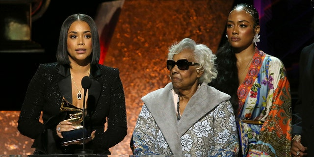 """Lauren London, from left, Margaret Boutte, and Samantha Smith accept the award for best rap performance for """"Racks in the Middle"""" on behalf of Nipsey Hussle at the 62nd annual Grammy Awards on Sunday, Jan. 26, 2020, in Los Angeles."""
