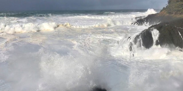 In this Saturday, Jan. 11, 2020, photo strong waves crash on the seashore near Otter Rock in Lincoln County, Ore.