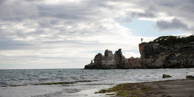 """A natural formation known as """"Punta Ventana,"""" or Window Point, stands without the bridge that once created the formation of the window, or a hole, in Guayanilla, Puerto Rico."""