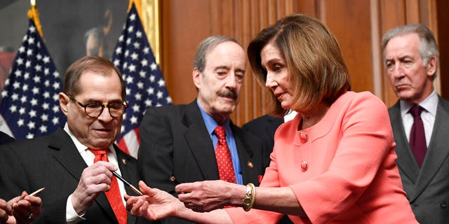 House Speaker Nancy Pelosi of Calif., second from right, gives pens to fellow Democrats after she signed the resolution to transmit the two articles of impeachment against President Donald Trump to the Senate for trial on Capitol Hill in Washington, Wednesday, Jan. 15, 2020. (Associated Press)