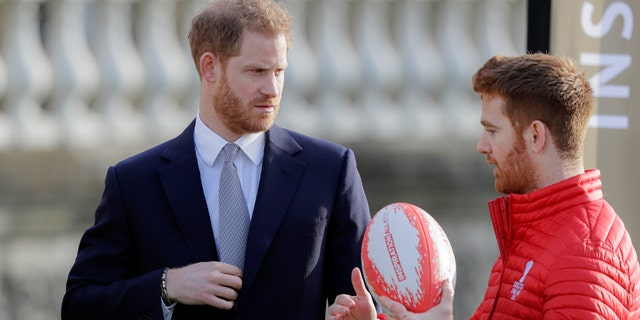 Prince Harry listens to Rugby League World Cup 2021 ambassador James Simpson in the gardens at Buckingham Palace in London on Thursday.