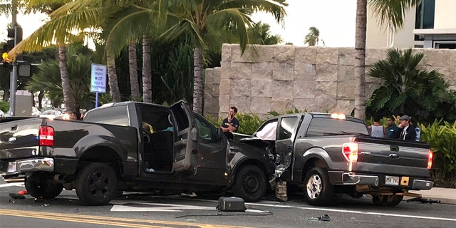 FILE - This archive photo from Monday, January 28, 2019 shows the scene of a multi-vehicle accident involving two trucks and a cyclist in Honolulu. Police say a suspicious drunk driver crashed into a busy intersection in Honolulu, killing two pedestrians and a cyclist and injuring five people, including himself. (Cindy Ellen Russell / Honolulu Star-Advertiser via AP)